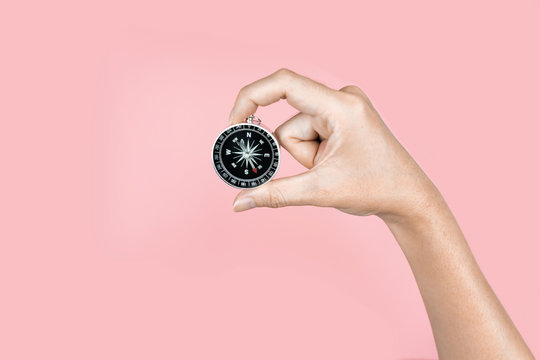 Hand holding compass In the travel concept