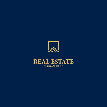 logo for real estate business on blue background