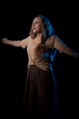 Girl Actress on stage plays emotions in blue theatrical light