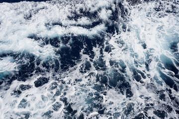 Aerial view to ocean waves.