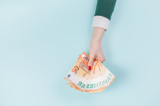 Female hands with cash, euro banknotes.