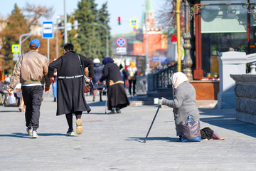 Moscow, Russia - April, 1, 2019: beggars begging near the Cathedral of Christ the Savior in Moscow, Russia