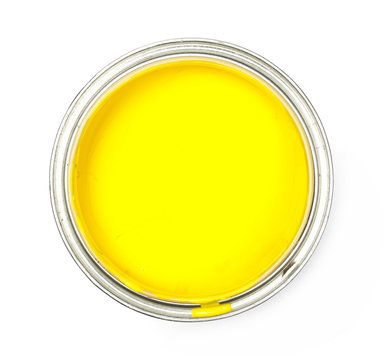 Open yellow paint can isolated on white background, top view