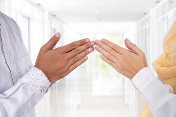 close up gesture of hand finger tip touching. islam muslim greeting eid mubarak
