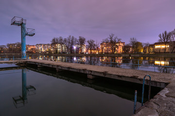 View on the lake with swimming area at night in Ivano-Frankivsk city