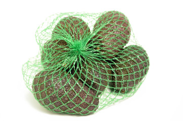 Avocados in a plastic grid.