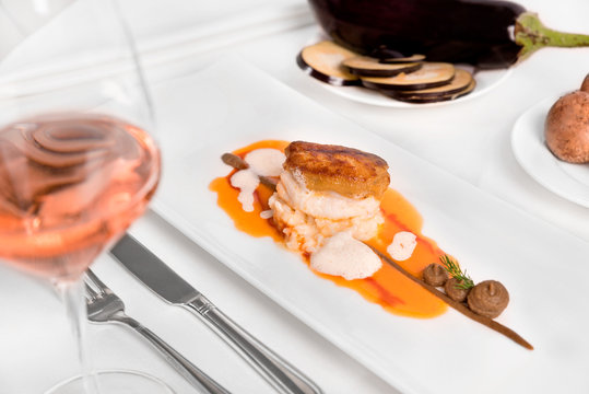 Monkfish fillet with eggplant and tomatoes.