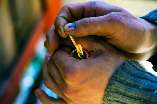 smoking cannabis of a bottle, medical smoking weed,homemade bong,rasta Man sets fire to weed,use marijuana
