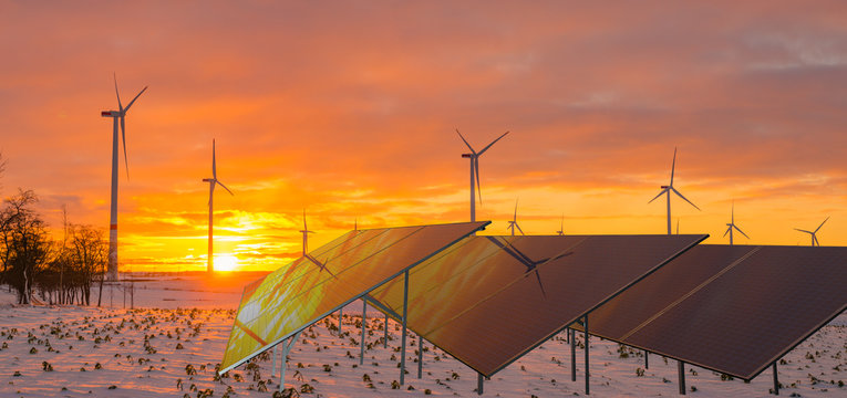 solar panels and wind turbines working in winter