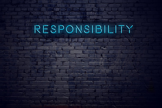 Brick wall and neon sign with text responsibility