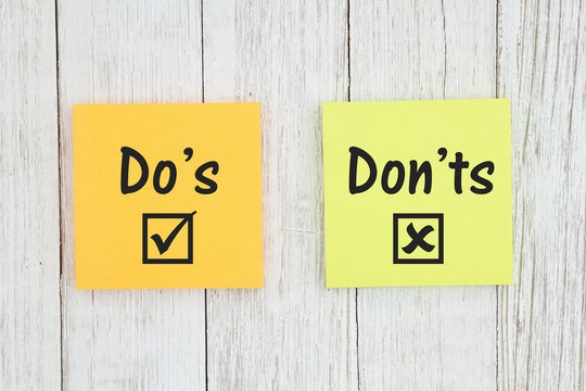 Do's and Don'ts on two sticky notes  on weathered whitewash textured wood