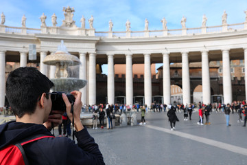 young photographer in Saint Peter Square in Vatican City