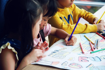 Kids boy and girls learning drawing in holiday weekend.