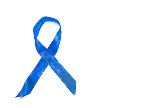 Blue Awareness Ribbon isolated on white background with copy space. Addiction, ARDS, colon cancer, Huntington's Disease.