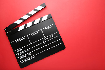 Clapper board on red background Wall mural