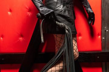 Female hand hold leather lash with fringe