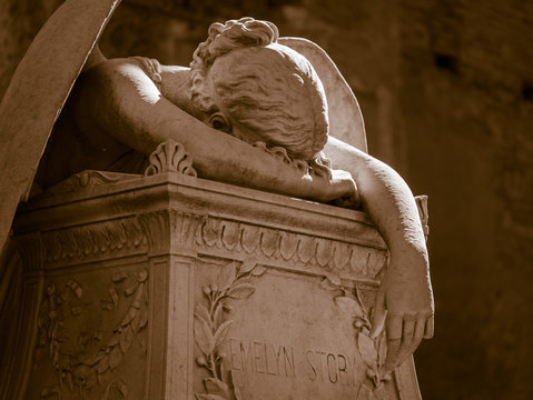 More than 100 years old statue. Cemetery located in Rome