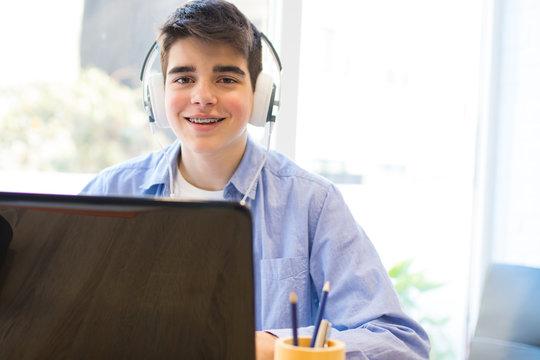 teen computer and headphones