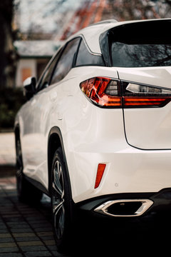 Close up photo of back view luxury car with futuristic tail lights