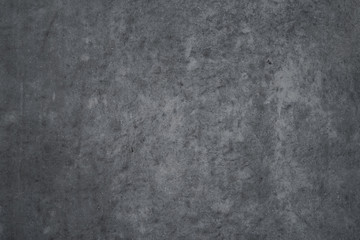 Texture of dark gray concrete wall as an abstract background