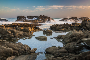 Tidal pools with rocks and waves of the ocean Wall mural