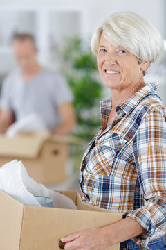 cheerful senior couple moving into new home