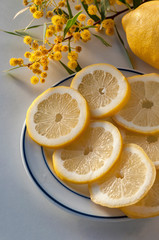 Whole lemon fruit and slices with mimosas