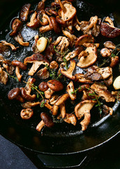 Sauteed mushrooms with butter and herbs in skillet