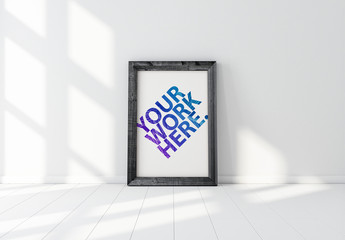 Vertical Wooden Frame Leaning on a White Wall Mockup