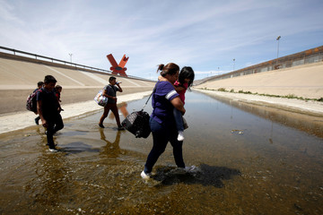 Migrants from Central America are seen at the Rio Bravo while crossing illegally to turn themselves in to request asylum to U.S. Customs and Border Protection (CBP) officials in El Paso, Texas, U.S., in this picture taken from Ciudad Juarez