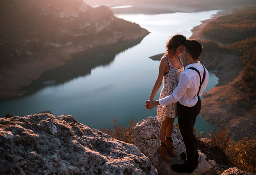 Young couple standing face to face in mountain landscape