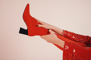 Leg of woman in red clothes