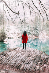 Young woman exploring turquoise lake in Switzerland