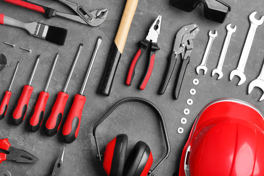 Flat lay composition with different construction tools on grey background