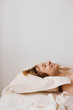Happy woman laying on the bed