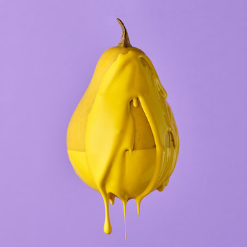 pear isolated on purple background