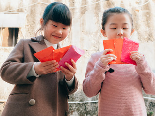 happy Chinese little girl with red packet
