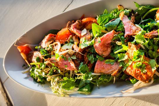 thai beef salad in warm afternoon light
