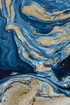 Navy blue paint and gold paint abstract