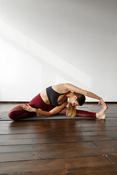Stretching sportive woman practicing yoga