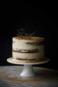"""Pumpkin spice """"""""naked cake"""""""" with cinnamon dusting and dried twigs"""