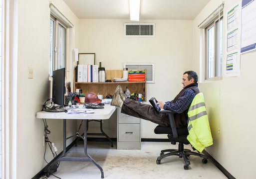 Construction worker resting in office
