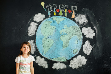 Portrait of little girl with planet earth and children chain unity