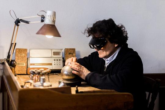 Man making handmade rubber stamp