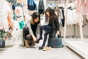 Mom shopping with little daughter