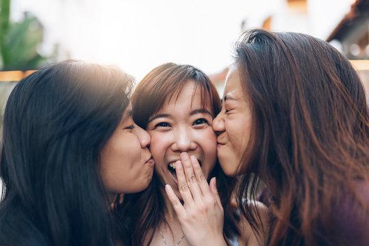 Friends women having fun in street