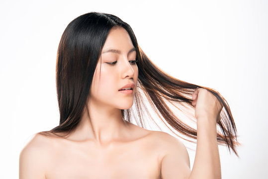 beautiful asian women are holding hair