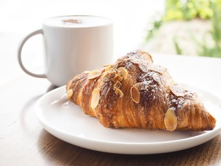Freshly Baked Almond Croissant With Cafe Latte