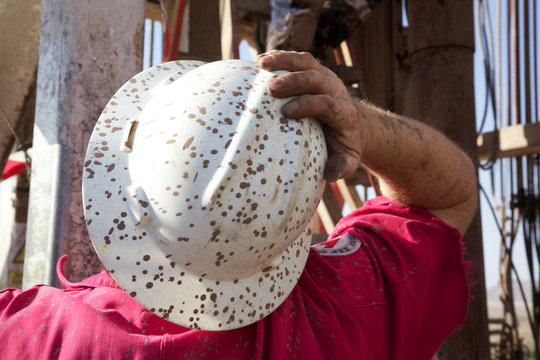 Worker with dirty hardhat
