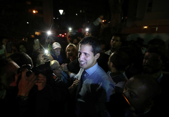 Venezuelan opposition leader Juan Guaido, who many nations have recognized as the country's rightful interim ruler, talks to media during a news conference in Caracas